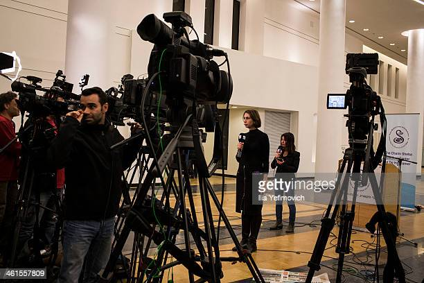 Members of the press prepare to report while waiting for an update on Former PM Ariel Sharon's condition at the Tel Hashomer hospital on January 9...