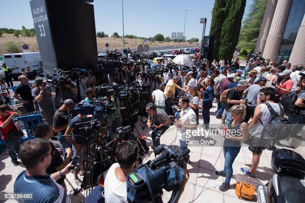 Members of the press react after hearing Cristiano Ronaldo of Real Madrid had left the Spanish courthouse in Madrid where he had testified in a case...