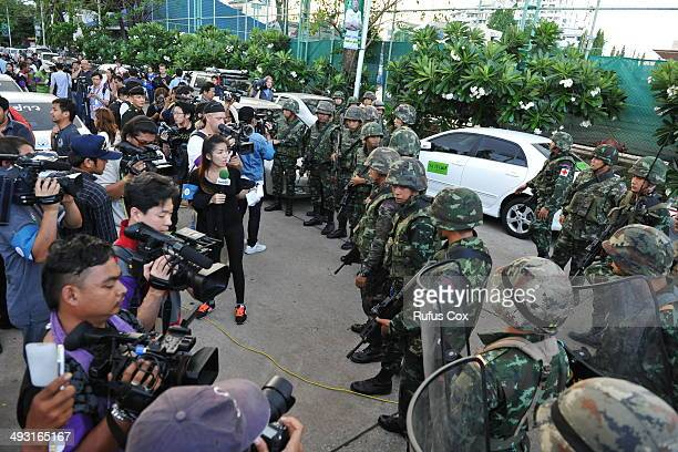 Members of the press report from the venue for peace talks between pro and antigovernment groups on May 22 2014 in Bangkok Thailand The army chief...