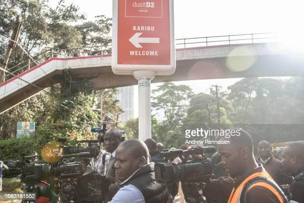 Members of the press stand outside the Dusit Hotel on January 16 2018 in Nairobi Kenya A security operation continued into a second day after...