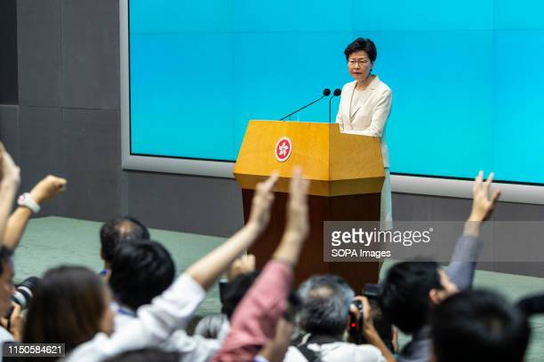 Members of the press trying to ask questions as the Hong Kong Chief Executive Carrie Lam speaks during a press conference at the government...