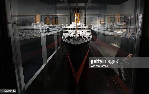 Members of the press view exhibits during a media preview of a new exhibit 'Titanic 100 Year Obsession' at the National Geographic Museum which...