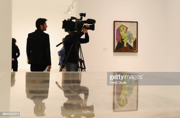 Members of the press view paintings by Pablo Picasso during the presentation of the exhibition 'Pity and Terror in Picasso The Path to Guernica' at...