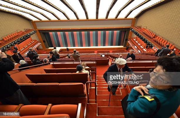 Members of the press visit the recently rebuilt kabuki art theatre in Tokyo on March 25 2013 The theatre in the upscale Ginza shopping district which...