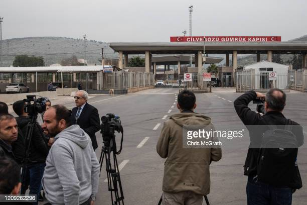 Members of the press wait in front of the Turkish Cilvegozu Border Gate from Syria on February 28, 2020 in Hatay, Turkey. Turkey announced that it...