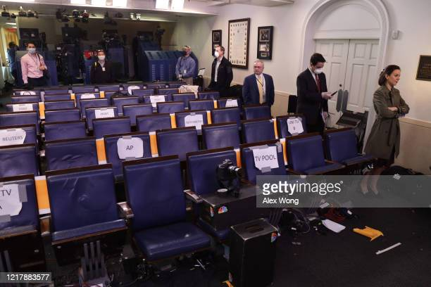 Members of the press wait in-line in the James Brady Press Briefing Room for a COVID-19 test April 9, 2020 at the White House in Washington, DC. The...