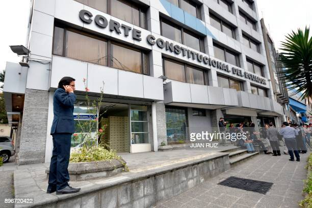 Members of the press wait outside the Constitutional Court for news about the possible impeachment of Ecuadorian Vice President Jorge Glas in...