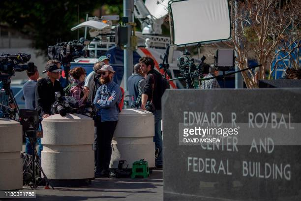 Members of the press wait outside the Edward R Roybal Federal Building and US Courthouse where actress Lori Loughlin attended her initial hearing in...