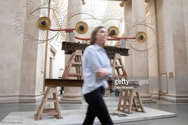 Members of the press walk around a new installation by British Artist Mike Nelson after a press call at Tate Britain on March 18 2019 in London...