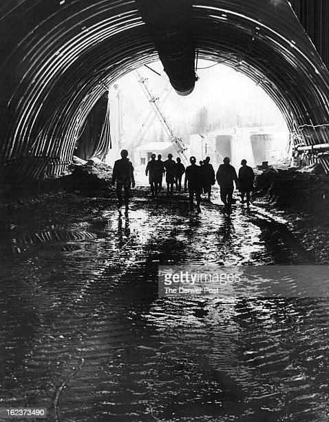 AUG 21 1968 AUG 22 1969 Members of the press walk toward the east portal of the $50 million Straight Creek Tunnel hear the base of Loveland Pass...