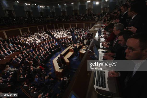 Members of the press watch the State of the Union address in the chamber of the US House of Representatives at the US Capitol Building on February 5...