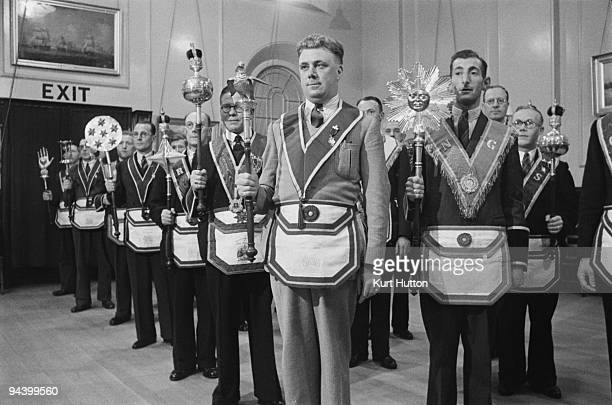 Members of the 'Pride of Clapham' lodge of the Manchester Unity of Odd Fellows an independent friendly society in their full regalia August 1939 To...