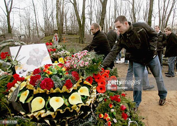 Members of the Primus Worldstars including Tie Domi and Alexandre Daigle pay their respects at the gravesite of former NHL player Sergei Zholtok on...