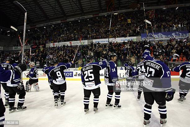 Members of the Primus Worldstars salute the fans of SC Bern following their exhibition match on December 15, 2004 at Bern Arena in Bern Switzerland....