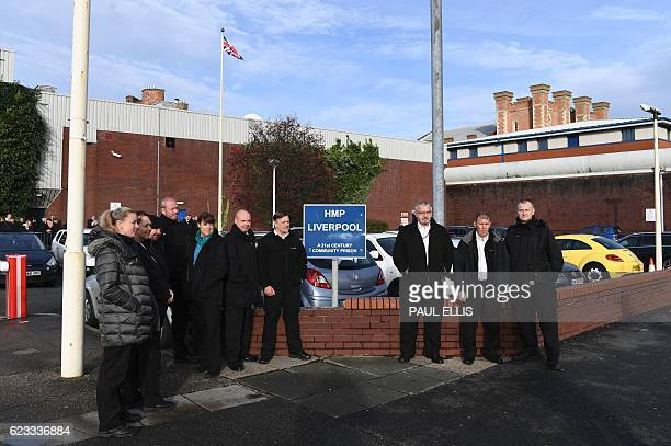 Members of the prison service gather outside HMP Liverpool northwest England on November 15 2016 after prison officers stopped work in protest over...