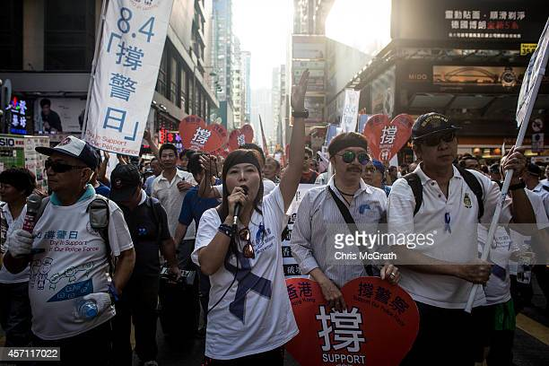 Members of the progovernment Blue Ribbon group march through the streets of Mong Kok to protest the lack of police action against prodemocracy...