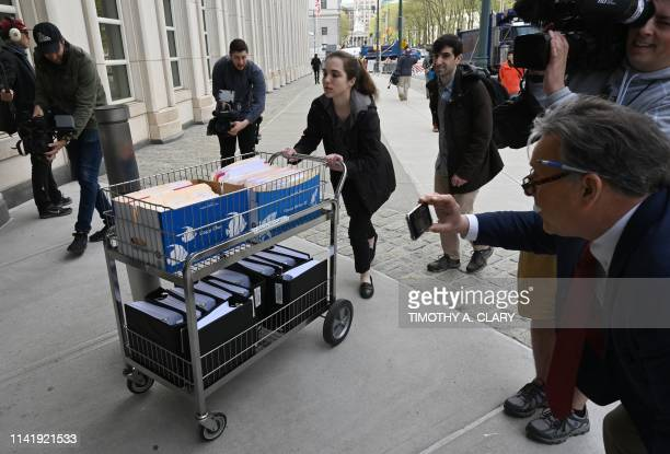 Members of the prosecution in the Nxivm case arrive with documents at Brooklyn Federal Court on May 7 for day one of the trial of Keith Raniere,...