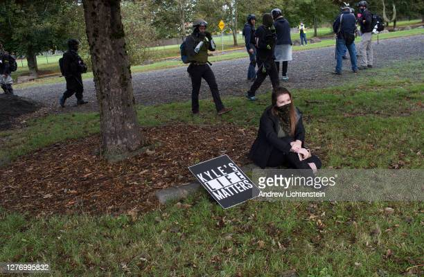 Members of the Proud Boys, a far right organization dedicated to fighting with leftists, show their support for Kyle Rittenhouse during a rally on...