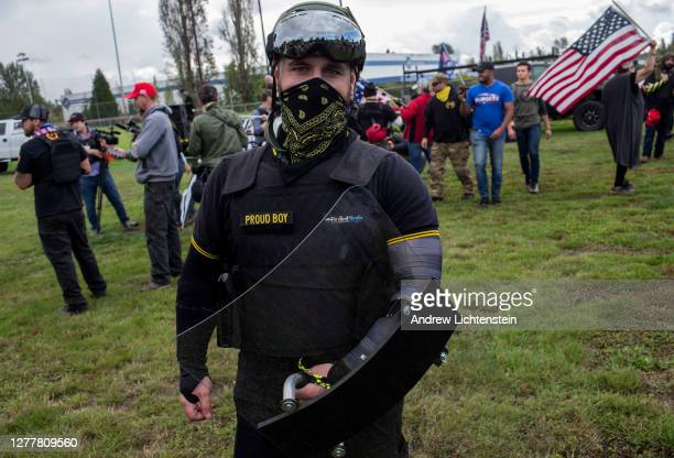 Members of the Proud Boys, a gang that supports President Trump, hold a rally on September 26, 2020 in Delta Park on the edge of Portland, Oregon.The...