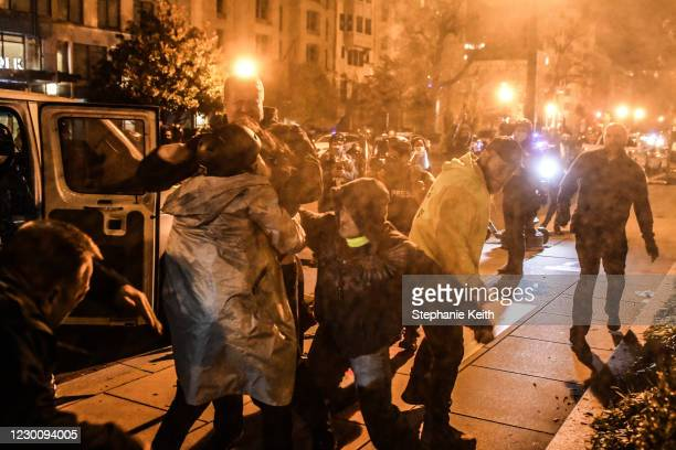 Members of the Proud Boys and Antifa clash during a protest on December 12, 2020 in Washington, DC. Thousands of protesters who refuse to accept that...