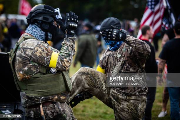 """Members of the Proud Boys and other similar groups attend a rally at Delta Park in Portland, Oregon on September 26, 2020. - Far-right group """"Proud..."""