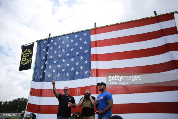 Members of the Proud Boys speak to the crowd during the rally. Hundreds of members of the far-right group Proud Boys arrived at Delta Park in...