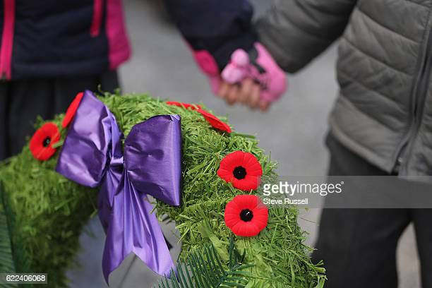 TORONTO ON NOVEMBER 11 Members of the public add their poppies to wreaths at the end of the ceremony A Remembrance Day ceremony is held in the...