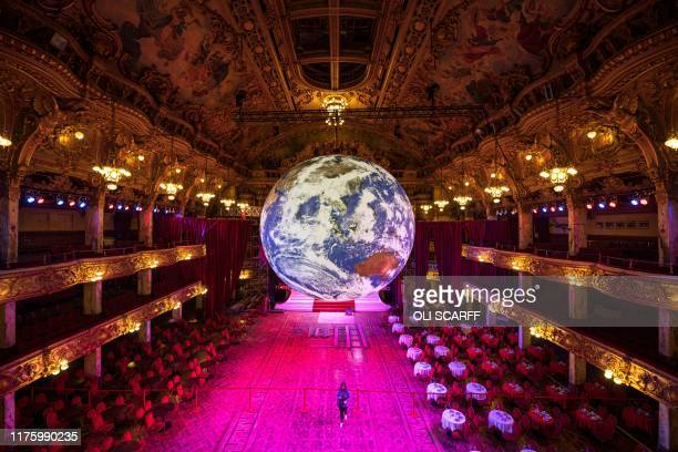 Members of the public admire an illuminated art installation entitled 'Gaia' by artist Luke Jerram in the Blackpool Tower Ballroom as part of the...