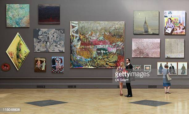 Members of the public admire the artwork on display in the Royal Academy of Arts' Summer Exhibition on June 2, 2011 in London, England. The Summer...