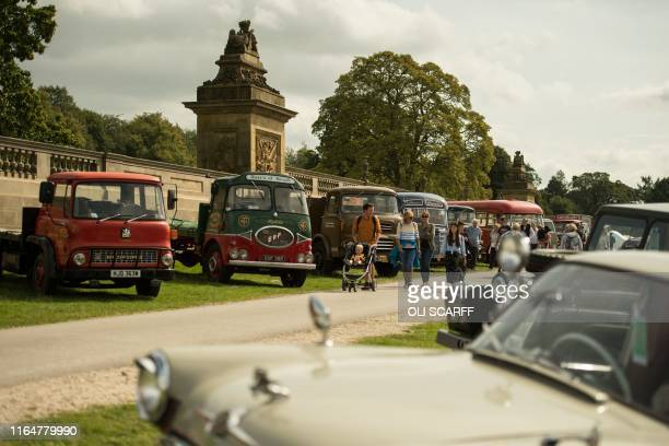 Members of the public admire the classic vehicles on display on the first day of the Chatsworth Country Fair in the grounds of Chatsworth House, near...