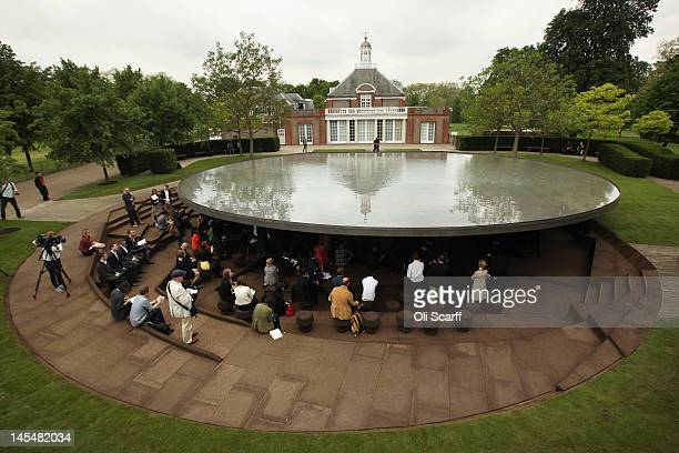 Members of the public admire the new Serpentine Gallery Pavilion in Hyde Park on May 31 2012 in London England The pavilion which was designed by...