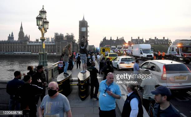 Members of the public and Emergency Services gather on Westminster Bridge on April 23 2020 in London United Kingdom Following the success of the Clap...