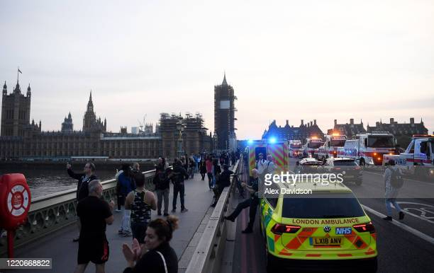 Members of the public and Emergency Services gather on Westminster Bridge on April 23, 2020 in London, United Kingdom. Following the success of the...