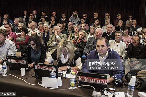Members of the public and journalists watch as councilors attend a City Council meeting on September 29 2015 in ChalonsurSaone eastern France The end...