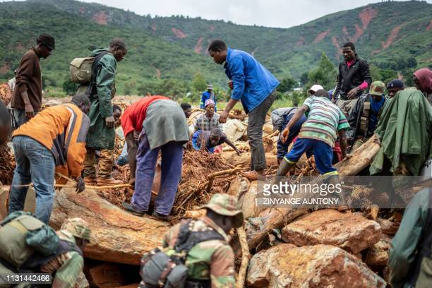 Members of the public and military personnel search for survivors and bodies in Ngangu township Chimanimani Manicaland Province eastern Zimbabwe on...