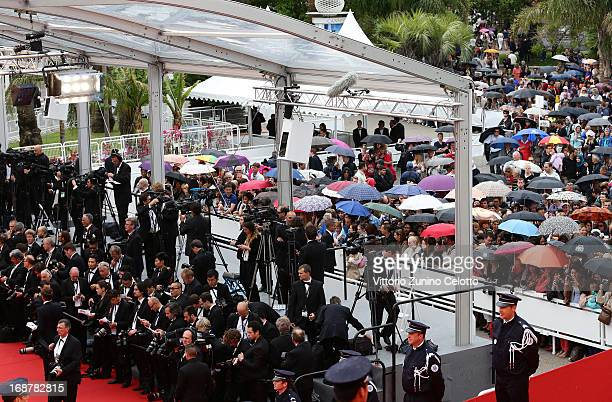 Members of the public and photographers wait for the Opening Ceremony and 'The Great Gatsby' Premiere during the 66th Annual Cannes Film Festival at...
