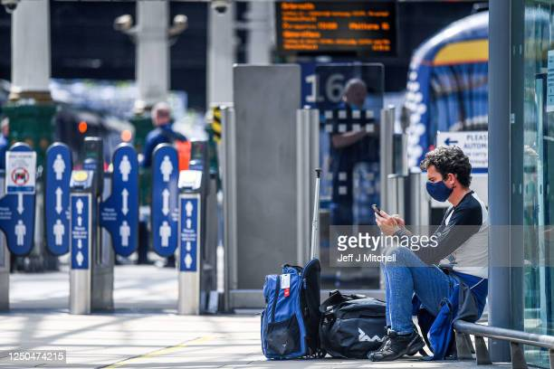 Members of the public and railway staff wear face masks in Waverley Station on June 18, 2020 in Edinburgh, Scotland. First Minister Nicola Sturgeon...