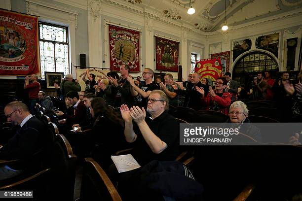 Members of the public applaud a speaker of the Orgreave Truth and Justice Campaign during a media conference at the National Union of Mine Workers in...