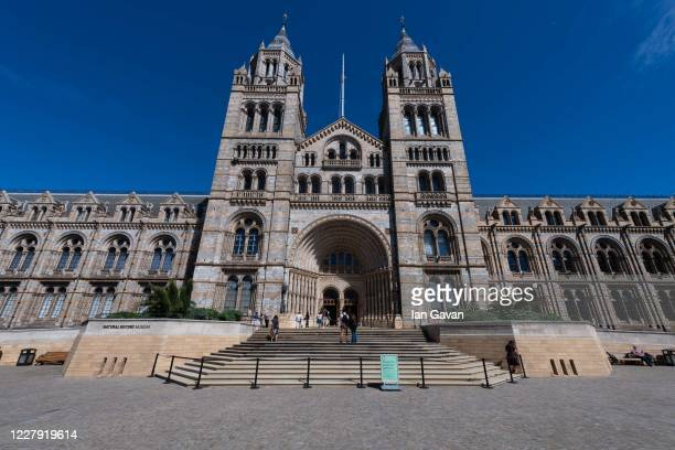 Members of the public approach the building during the reopening of the Natural History Museum on August 5, 2020 in London, England. The museum...