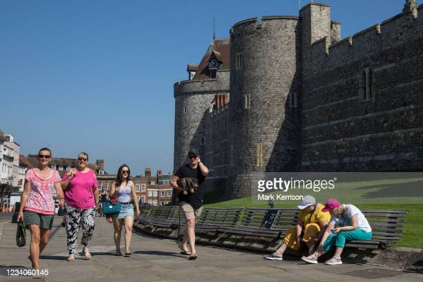 Members of the public approach Windsor Castle on 'Freedom Day', when the UK government lifted almost all remaining Covid-19 restrictions in England,...