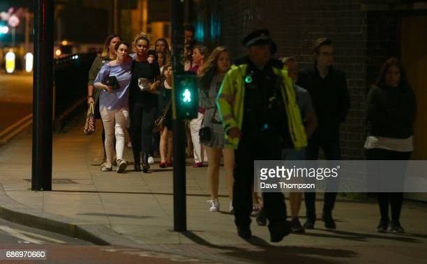 Members of the public are escorted from the Manchester Arena on May 23 2017 in Manchester England An explosion occurred at Manchester Arena as...