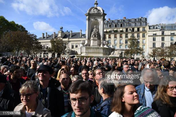 TOPSHOT Members of the public are gathered outside of the SaintSulpice church in Paris during the church service for former French President Jacques...