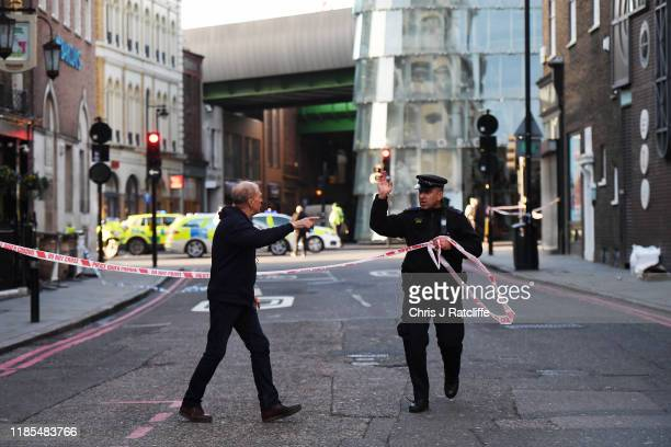 Members of the public are held behind a police cordon near London Bridge train station after reports of shots being fired on London Bridge on...