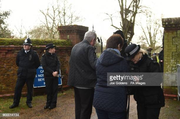 Members of the public are searched as they arrive to watch members of the royal family attend the morning church service at St Mary Magdalene Church...
