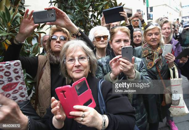 Members of the public are seen as Prince Charles Prince of Wales and Camilla Duchess of Cornwall visit Sant'Ambrogio Market to celebrate the Slow...