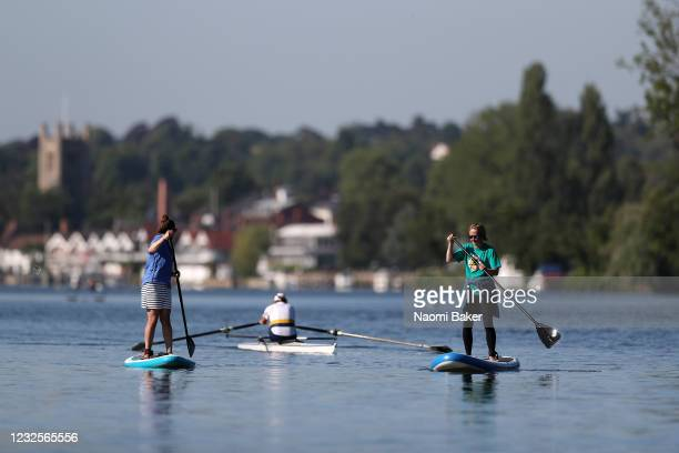 Members of the public are seen enjoying the relaxation of lockdown as they are seen Rowing and Paddle Boarding on the River Thames in on May 29 2020...