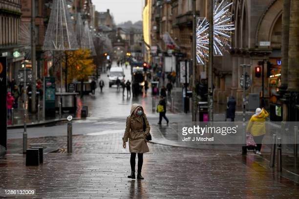 Members of the public are seen in Glasgow City Centre on November 17, 2020 in Glasgow, Scotland. First Minister Nicola Sturgeon is due to announce...