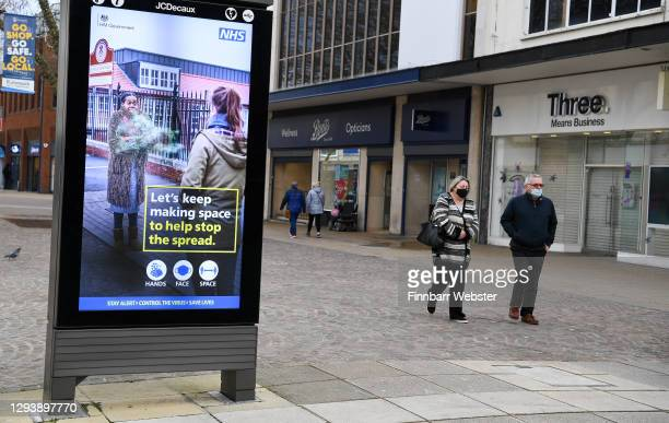 Members of the public are seen in the shopping areas around the city centre on December 31, 2020 in Portsmouth, England. From Thursday,...