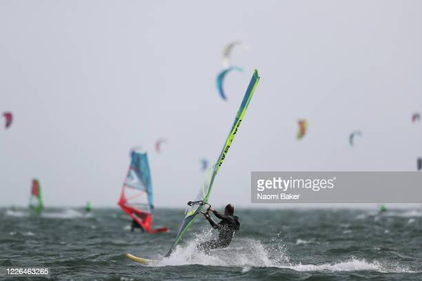 Members of the public are seen kitesurfing and windsurfing at Hayling Island Beach on May 22 2020 in Hayling Island England The British government...