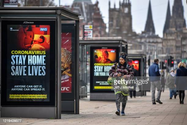 Members of the public are seen out on Princess Street during the coronavirus pandemic on April 17, 2020 in Edinburgh, Scotland.The Coronavirus...